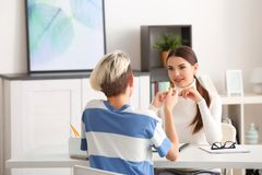 Young female psychologist working with teenager boy in office Stock Photography