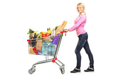 Young female pushing a shopping cart Royalty Free Stock Photography