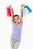 Young female raising her shopping bags Royalty Free Stock Images