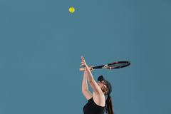 Young Female Ready To Serves Toss Ball Stock Image