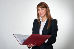 Young female with a red binder Stock Photography