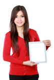 Young female in red showing blank tablet Stock Photography