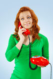 A young female with red telephone Stock Photography