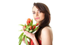 Young female with red tulip flowers, isolated Royalty Free Stock Image