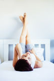 Young female relaxin in her home Royalty Free Stock Photography