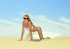 young female relaxing on the beach Royalty Free Stock Photos