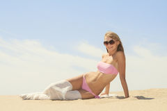 Young female relaxing on the beach Royalty Free Stock Image
