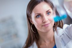 Young, female researcher in a lab. Young, female researcher carrying out experiments in a lab shallow DOF; color toned image Royalty Free Stock Photography