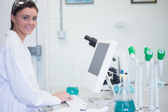 Young female researcher using computer in lab Royalty Free Stock Photography