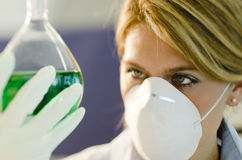 Young female researcher working with beaker Stock Photos