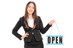 Young female retailer holding an open sign Royalty Free Stock Photo