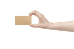 Young female right hand hold blank brown paper card Royalty Free Stock Image