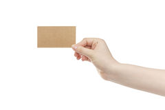 Young female right hand hold blank brown paper card. Isolated on white Royalty Free Stock Photography