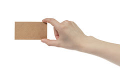 Young female right hand hold blank brown paper card. Isolated on white Stock Images