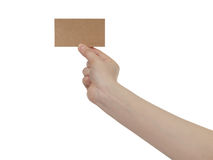 Young female right hand hold blank brown paper card. Isolated on white Royalty Free Stock Image