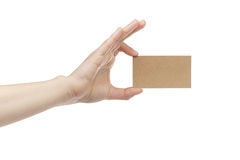 Young female right hand hold blank brown paper card. Isolated on white Royalty Free Stock Images
