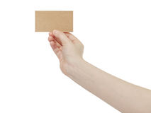 Young female right hand hold blank brown paper card. Isolated on white Stock Photo