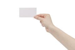 Young female right hand hold blank white paper card. Isolated on white Stock Photos