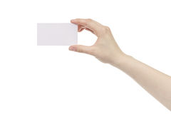 Young female right hand hold blank white paper card. Isolated on white Stock Photo