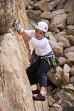 Young female rock climber. Royalty Free Stock Photos