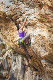 Young female rock climber royalty free stock photo