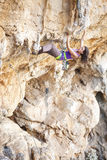 Young female rock climber Stock Images