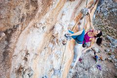 Young female rock climber on a cliff. Face Royalty Free Stock Photo