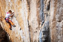 Young female rock climber on a cliff Royalty Free Stock Images
