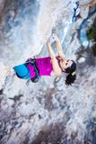 Young female rock climber on a cliff Stock Image