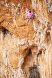 Young female rock climber on a cliff Stock Images