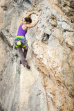 Young female rock climber Stock Photography