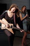 Young female with rock guitar Stock Images