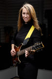 Young female with rock guitar Royalty Free Stock Images