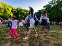 Young female round dance on Ivana Kupala fest. Uzhgorod, Ukraine - 07 Jul, 2016: Young female round dance on Ivana Kupala fest. Popular holiday in Slavic culture Stock Images