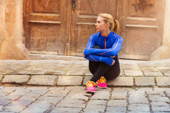 Young female runner in old city center Stock Photography
