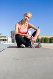 Young female runner resting after workout outdoors Royalty Free Stock Photos