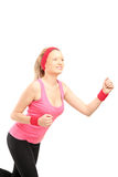 A young female runner running stock image