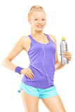 Young female in running outfit posing with a drink bottle Stock Images