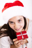 Young female Santa with Christmas gift Royalty Free Stock Photography