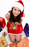 Young female Santa with Christmas gift Stock Photography