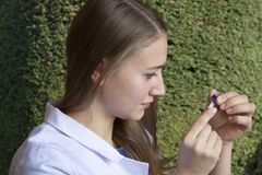 Young female scientist biologist on plants background stock images