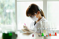 Young female scientist at laboratory Stock Image