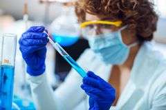 Young female scientist in protective glasses and gloves Stock Photo