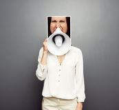 Young female screaming in megaphone Stock Photography