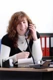 Young female secretary on the phone Stock Photo
