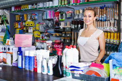 Young female seller standing at pay desk in supermarket Stock Images
