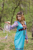 Young female Shaman in the woods. Portrait of a young lady - Female sorcerer Royalty Free Stock Photography