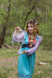 Young female Shaman in the woods. Portrait of a young lady - Female sorcerer Royalty Free Stock Images