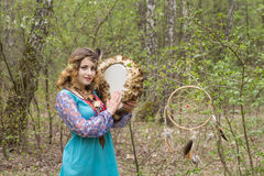 Young female Shaman in the woods. Portrait of a young lady - Female sorcerer Stock Image
