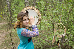 Young female Shaman in the woods. Royalty Free Stock Images